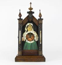 Wooden Cathedral Clock with Moving Eyeballs. Unsigned. Finials Repaired. Measures 21 Inches Tall. The Gallery does Not warranty the running condition of Clocks or the Parts. Please Examine All Clocks Carefully Before Bidding or ask for Specific Photos. Shipping $40.00