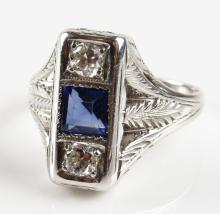 Art Deco 18 Karat White Gold, 0.20 Carat Diamond and Sapphire Cigar Band Style Ring, Size 3. Signed 18K. Good Condition. Weighs 2.10 Pennyweights. Shipping $20.00