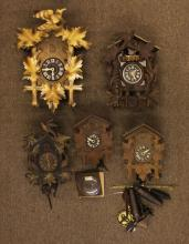 Five (5) Coo Coo Clocks. Condition Varies. The Gallery does Not warranty the running condition of Clocks or the Parts. Please Examine All Clocks Carefully Before Bidding or ask for Specific Photos. Shipping $75.00