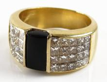 18 Karat Yellow Gold, 3.00 Carat Diamond and Black Onyx Ring, Size 6-1/2. Unsigned. Good Condition. Weighs 6.90 Pennyweights. Shipping $20.00