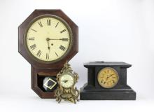 Large Wall Clock, Black Wooden Pedestal Clock and Gilt Metal Shelf Clock. Condition Varies. Wall Clock Measures 24 Inches Long and 16-1/2 Inches Wide. Please Examine This Lot Carefully Before Bidding. We Are Selling This Lot in