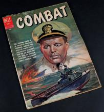 1962 Dell Combat Comic #4 JFK Story. Cover Disconnected and a few small tears to upper edge, Toning Throughout. Shipping $20.00