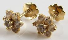 Pair of Children's 14 Karat Yellow Gold and Diamond Screwback Earrings. Unsigned. Good Condition. Gross Weighs 0.5 Pennyweights. Shipping $20.00