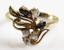 14 Karat Yellow Gold, Diamond and Sapphire or Black Onyx Ring, Size 7. Signed 14K and Makers Marks. Good Condition. Weighs 1.50 Pennyweights. Shipping $20.00