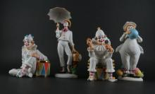 Four (4) Doulton International Ben Black Carnival of Clowns Porcelain Figures. All Signed. Good Condition. Tallest with Umbrella Measures 11-1/2 Inches. Shipping $50.00