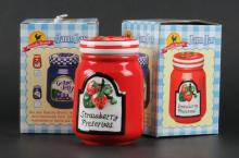 Two (2) Basically Brunch Strawberry Preserve Jam Jar in Original Box. Signed. Good Condition. Measures 5 Inches Tall and 3-1/2 Inches Long. Shipping $20.00