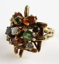 14 Karat Yellow Gold, Diamond and Multi Color Gemstone Ring, Size 7. Unsigned. Good Condition. Weighs 7.30 Pennyweights. Shipping $20.00