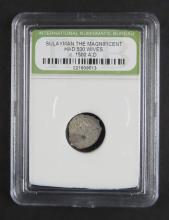 Sulayman The Magnificent Had 500 Wives Silver Coin Circa 1500AD encased in Plastic Holder. This Coin is NOT Professionally Graded, We DO NOT Grade Coins, Please See Photos and/or Information to Make your Own Value Judgment as to the Condition of this Coin. Shipping $20.00