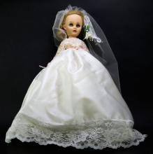 Plastic Antique Doll in Wedding Dress. Good Condition. Unsigned. Measures 20 Inches. Shipping $30.00