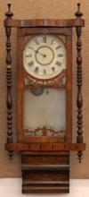 Antique Inlaid Regulator Wall Clock with Scrollwork. Has Carved Finials, Tin Dial and Interesting Glass Front. Measures 38 Inches Tall and 15 Inches Wide. Not in Working Condition. Shipping $75.002