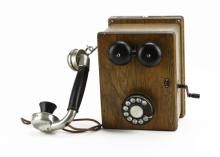 Antique General Electric Oak Wooden Crank Wall Phone. Model Number 141W70. Metal and Plastic Hardware. Paint Residue to Receiver, Slight Wear or else Good Condition. Measures 11 Inches High by 8 Inches Wide and 8 Inches in Depth.