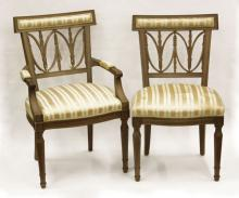 Six (6) Mid-Century Upholstered Mahogany Dinning Room Chairs with Metal Baker Tag. Some Wood Losses to Five (5) Chairs, Stained Upholstery on all Chairs or else Good Condition. Measures 35 Inches High by 20 Inches Wide. We Will Not Ship This Item Due to I