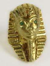 Vintage Egyptian Revival 14 Karat Yellow Gold and Emerald Tutankhamun Ring. Signed 14K. Good Condition. Ring Size 8. Weighs 14.30 Pennyweights. Shipping $20.00