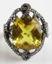 0.75 Carat Diamond, 7.30 Carat Briolette Cut Yellow Stone and 18 Karat Filigree White Gold Ladies Ring, Size 6-1/4. Signed 750. Weighs 4.70 Pennyweights. Shipping $20.00