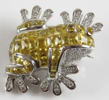 0.40 Carat Diamond, 9.29 Carat Yellow Stone and 18 Karat White Gold Frog Pin. Unsigned. Weighs 7.50 Pennyweights. Measures 1 Inch by almost 1 Inch. Shipping $20.00