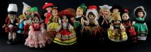 Collection Sixteen (16) Small Dolls of the World with Stands. Good Condition, 2 Stands Broken. Average Size Measures 8-1/2 Inches Tall. Shipping $30.00