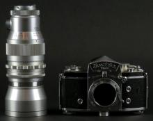 Exakta VXIIa Thagee Dresden German Body Camera together with Quinar 1:28 f=135mm Steinheil Munich Telephoto Lens. Camera Body Looks in Good Condition. Lens Seems to Have Bends at Both Ends and Should Be Looked at Carefully Before Bidding.