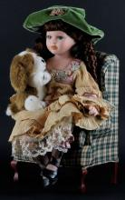 Girl Sitting in Chair With Puppy Porcelain Doll. Unsigned. Good Condition. Measures 19 Inches Tall and 10 Inches Long. Shipping $60.00