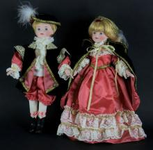 Two (2) Boy and Girl Porcelain Dolls With Matching Outfits. Unsigned. Good Condition. Measures 15 Inches Tall and 8 Inches Long. Shipping $25.00
