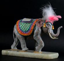 Limited Edition Ron Lee (1997) Circus Elephant Sculpture with Feathered Head Dressing Mounted on Onyx Base. Signed and Numbered 210/500. (No Box) Repair to Tail, Otherwise Good Condition. Measures 11 Inches Tall by 12 Inches Wide. Shipping $46.00