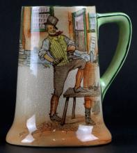 1908-1931 Royal Doulton Dickinsware Sam Weller Mug. Signed with Old Mark. Good Condition. Measures 5-5/8 Inches Tall. Shipping $20.00