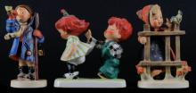 Three (3) Goebel Hummel Figurines Including: Hear Ye, Hear Ye Boy Scout Trumpet #15/0. Signed. Good Condition Together With Signs of Spring #203. Signed. And Charlot Redhead Guess Who Boy Girl Figurine. Signed. Good Condition. Tallest Measures 5-1/2 Inches Tall and 3-1/2 Inches Long. Shipping $20.00