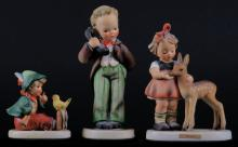 Three (3) Goebel Hummel Figurines Including: Hello # 124/0. Signed Good Condition, Friends # 136. Some Crazing Otherwise Good Condition and Singing Lessons # 63. Signed. Some Crazing Otherwise Good Condition. Tallest Measures 6-1/4 Inches Tall and 3 Inches Long. Shipping $20.00