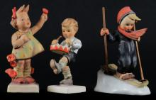 Three (3) Goebel Hummel Figurines Including: Little Drummer #240. Signed. Good Condition. Skier # 59. Signed. Good Condition and Cheer Spring # 72. Signed. Repair Done to Left Arm and Head Otherwise Good Condition. Tallest Measures-1/2 Inches Tall and 4 Inches Long. Shipping $20.00