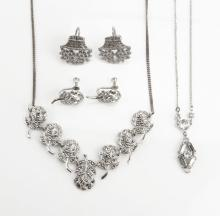 Sterling Silver and Marcasite Suite. Includes Two (2) Pairs of Earrings and Two (2) Necklaces. Good Condition. Total Weighs Approx. 23.5 Pennyweights. Shipping $15.00