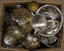 Box Lot of Assorted Pieces. Includes Stieff Pewter, Silver Plated Serving Pieces, Trays, Cups, etc. Please Examine All Items Carefully Before Bidding. Shipping $80.00