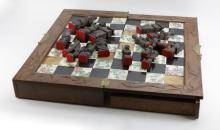 Oriental Portable Game Board with Carved Wooden Chess Pieces. Two (2) Pull out Drawers. Board Has Some Losses to Tiles, Panels on Drawer have Losses, Splits or Cracks to Some Game Pieces. Please Examine All Items Carefully Before Bidding. Board Measures 26