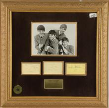 The Beatles, a framed display with three autographs pages, one signed by John Lennon & Paul McCartney on reverse, another by Paul McCartney and the other by George Harrison & Ringo Starr, framed in a presentation display with photograph, 18 x 18 inches.Provenance: With certificate of authenticity from Roger Epperson