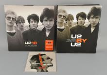 U2 18 Singles Complete set of promo items including U2 by U2 Hardback Book, U2 18 Singles Deluxe CD & DVD U218 Singles Double Vinyl, Note book, promo flyer, Singles DVD & CD in numbered slip case, 2 promo plastic bags, badges, key ring, Windows In The Sky 2CD & DVD single & promo CDR in limited edition sleeve, Singles Mug, U2 with Green Day The Saints Are Coming 7 inch Vinyl & promo CDR.