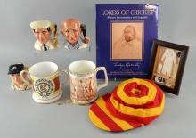 Cricket memorabilia including a signed limited edition print, 'The Spirit of Cricket' by Jocelyn Galsworthy, signed book by Jocelyn Galsworthy, cricket cap, three Toby Jugs & two commemorative mugs, all by Royal Doulton