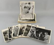 100+ 10 x 8 inch original photographic black & white movie film stills, stars & films including James Dean, Rebel Without A Cause, Peter Sellers, Joan Collins, Richard Burton, Miracle In The Rain, Eric Sykes, David Niven, King & Country, Grace Kelly, Anne Baxter & others, many stamped on reverse (100+)