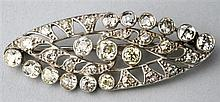 Edwardian marquise form openwork diamond brooch set with 11 old cut diamonds largest .5 carat