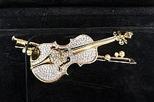 Swarovski brooch in the form of a cello