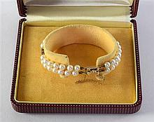 Mikimoto double strand cultured pearl bracelet with unmarked yellow metal links cased