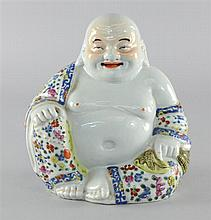 A Chinese famille rose figure of BUDAI-HO-SHANG seated holding his treasure bag. 20th Century