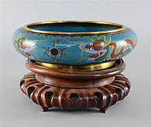 Chinese cloisonne bowl with inturned rim, decorated with dragons on a blue ground, 20th Century.