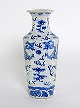 Chinese blue and white cylindrical vase, waisted neck decorated with dragons contesting a flaming pearl.