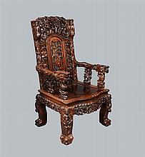 Late 19th /early 20th Century Chinese hardwood chair profusely carved with figures, bats and foliate forms