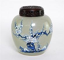 Chinese ginger jar. decorated in blue and white with blossoming prunus, rockwork, and birds on a celadon ground. Early 18th Century.