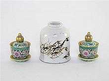 † Pair of Chinese famille rose miniature reticulated bowls with fixed covers and stands.