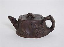 Chinese Yi Xing teapot modeled as a section of tree trunk with bark effect handle, four character seal mark, 19th / 20th Century