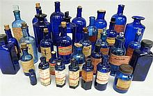 Collection of 32 blue glass 19th Century and later apothecary chemical storage jars