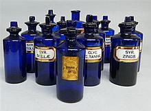 Collection of 12 19th Century blue glass apothecary chemical storage jars with stoppers