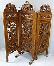 Indonesian indigenous carved three panel screen decorated with mythical beasts and foliate forms