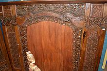 Indonesian indigenous carved wood and painted wall mirror
