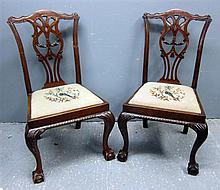 Set of eight 20th Century mahogany Chippendale style dining chairs with drop in seats, cabriole legs and ball and claw feet